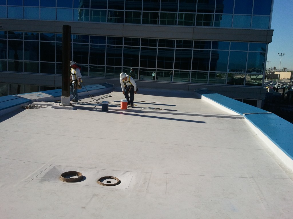 Picture of roofers working on a flat roofing for prestige roofing