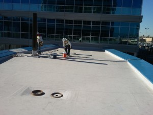 Picture of roofers working on a flat roof for prestige roofing