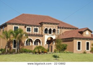 Executive Mediterranean style home with tile roof