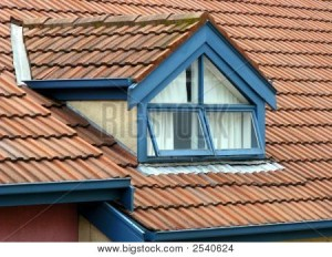 Custom blue roof gutters on red tile roof