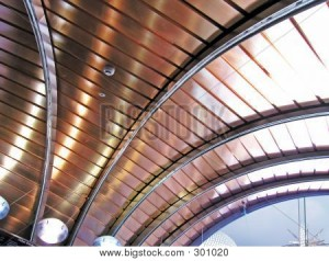 Slatted copper ceiling with dark beams
