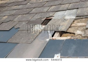 Shingle roof with broken shingles needing repair