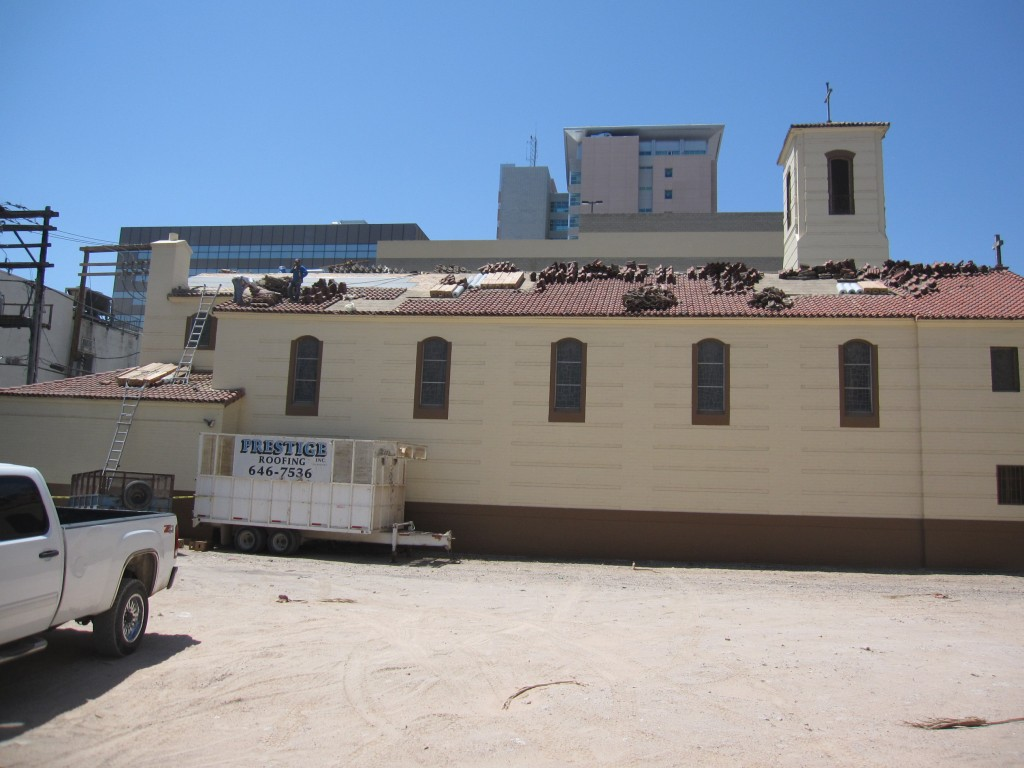 picture of a commercial building under roof repair