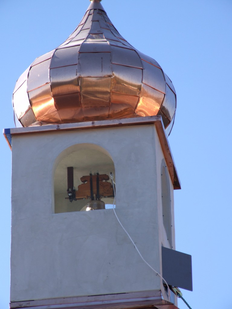 Copper fixture on church bell tower