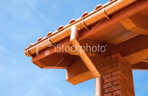 Copper raingutter and downspout on tile roof