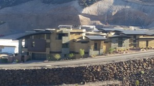 Distant view multiple Henderson homes with new copper roofing