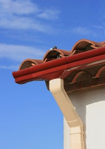 Pvc rain gutter system on a tiled roof