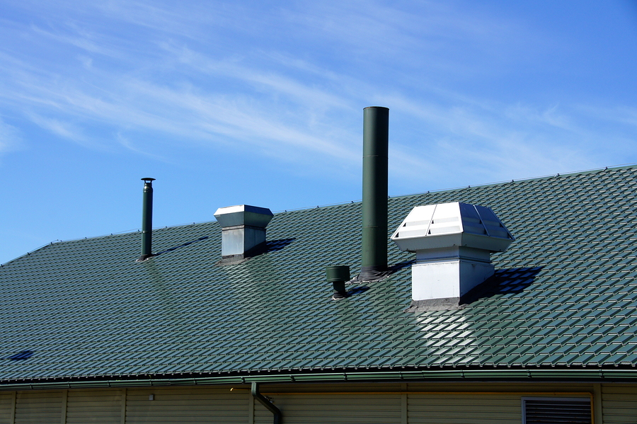 Different kinds of roof vents on a roof of a building