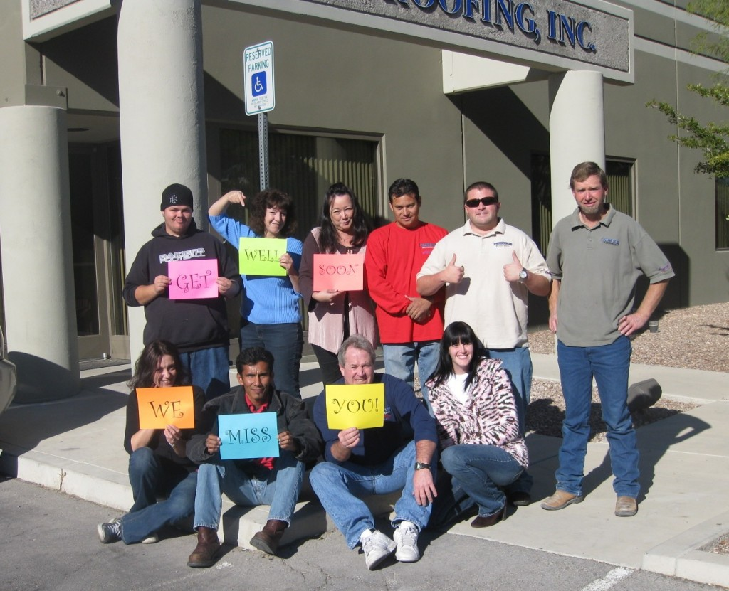 Prestige Roofing staff sending greeting to coworker