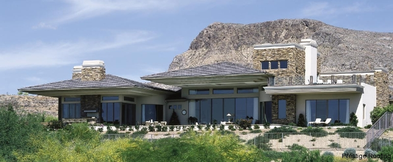 New gray tile roof by Prestige Roofing on single story rural luxury home in Las Vegas against natural mountain backdrop