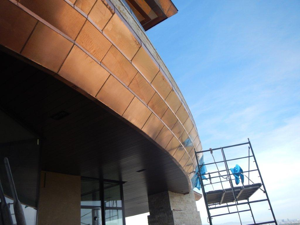 Custom design curved copper roof during installation on a luxury home in Henderson NV