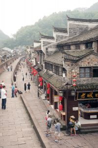 View on the wall and tiled roofs overlooking Fenghuang, China.