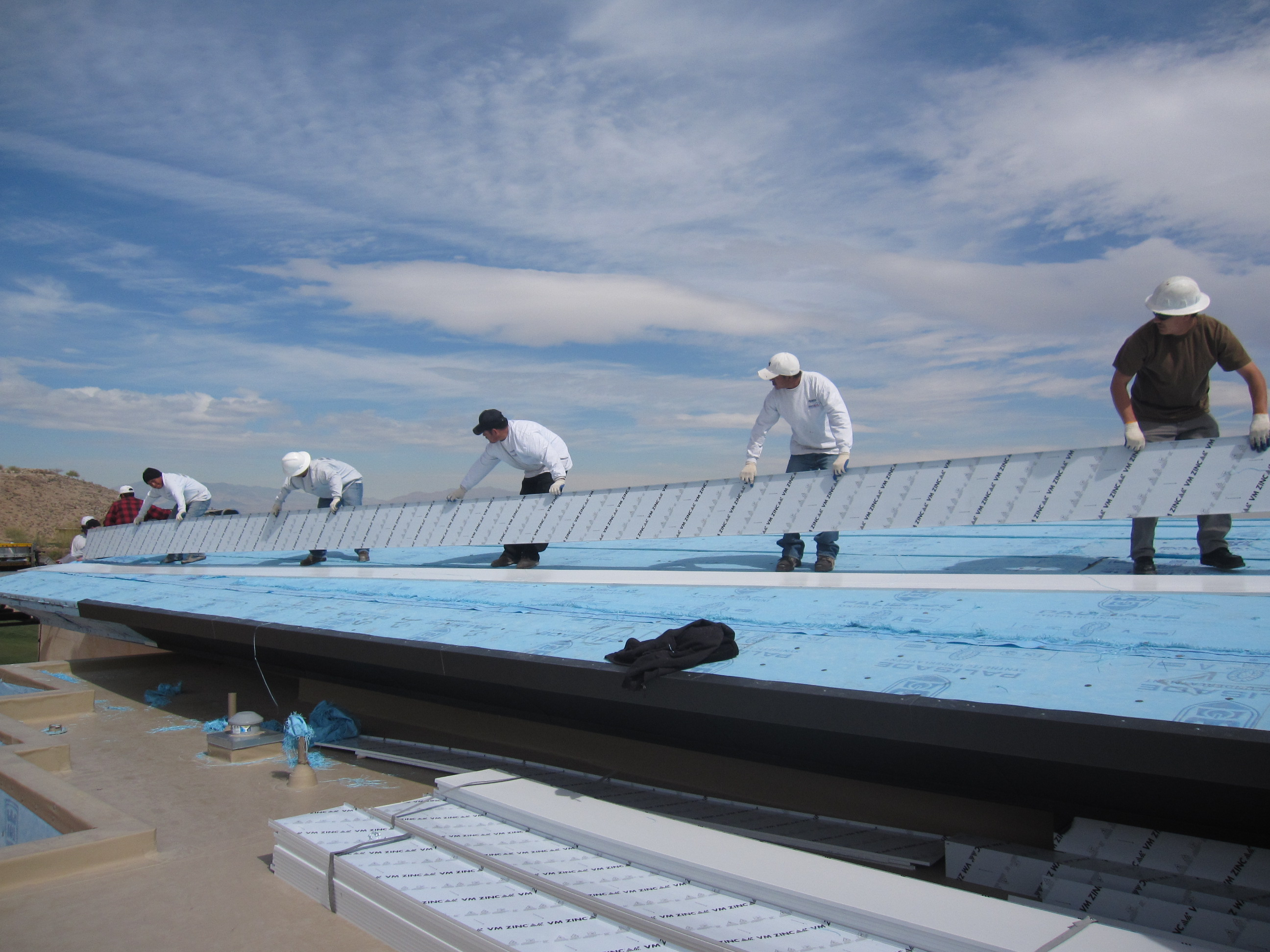 Prestige Roofing crew working on a downtown Las Vegas commercial roof installation