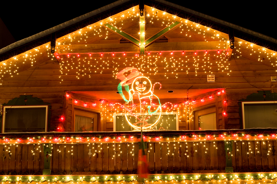 Christmas light strands on the eves of a home