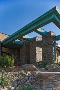 Copper roof fixture trellis form on luxury home with copper patina