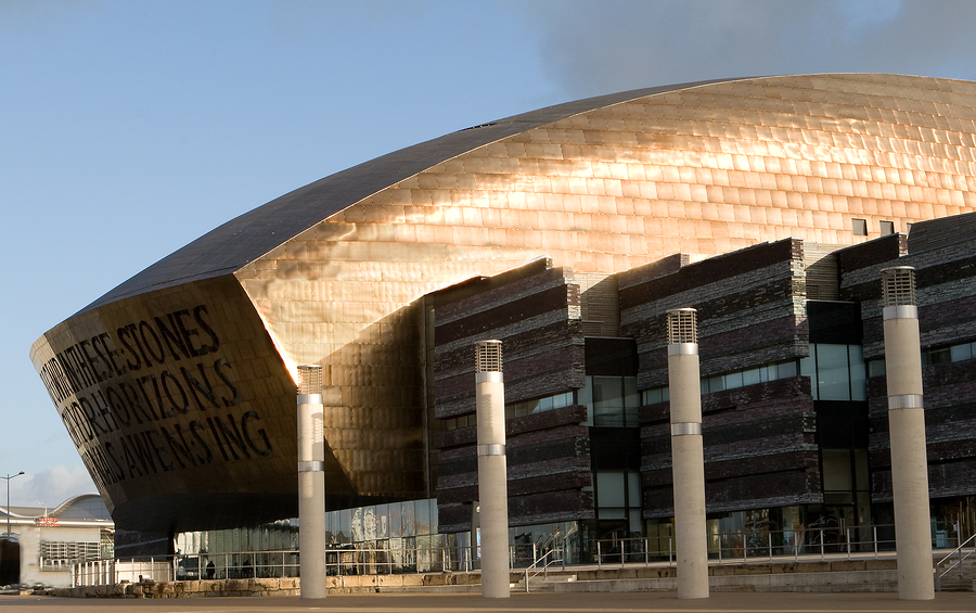 The Millenium Centre Cardiff Bay in sun with copper roof reflecting light