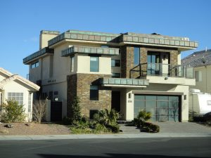 Residential home with copper roof that is showing patina shade of green and brown Las Vegas home