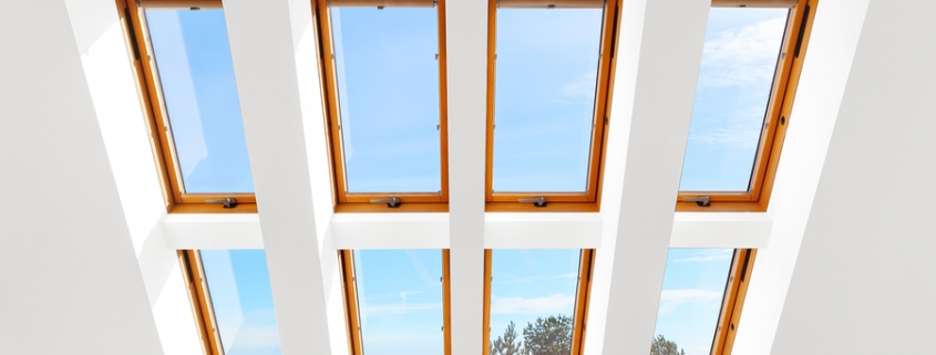 Group of eight large, wooden roof windows or skylights
