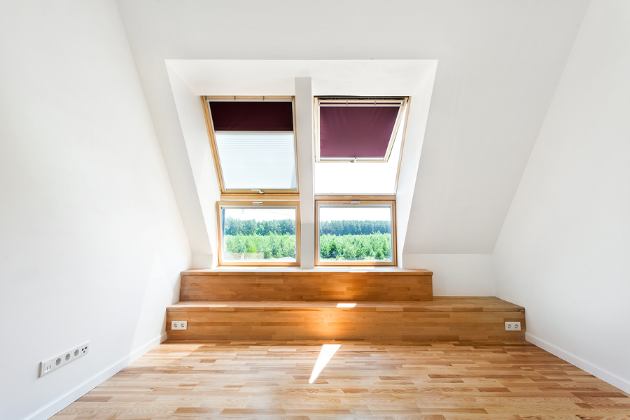 Empty Room of New Home with Wood Floors Bright Skylight Roof Windows