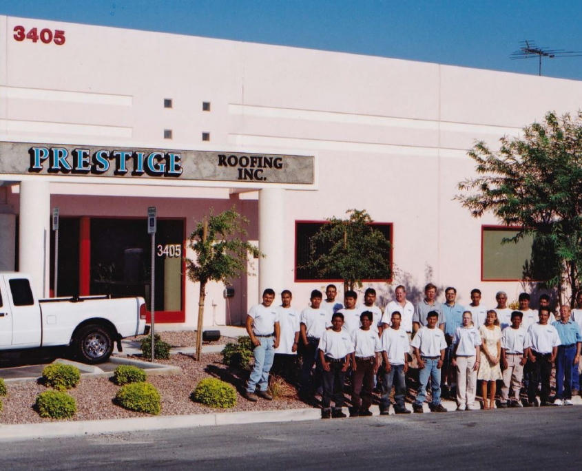 Prestige Roofing team photo in front of their North Las Vegas, NV building