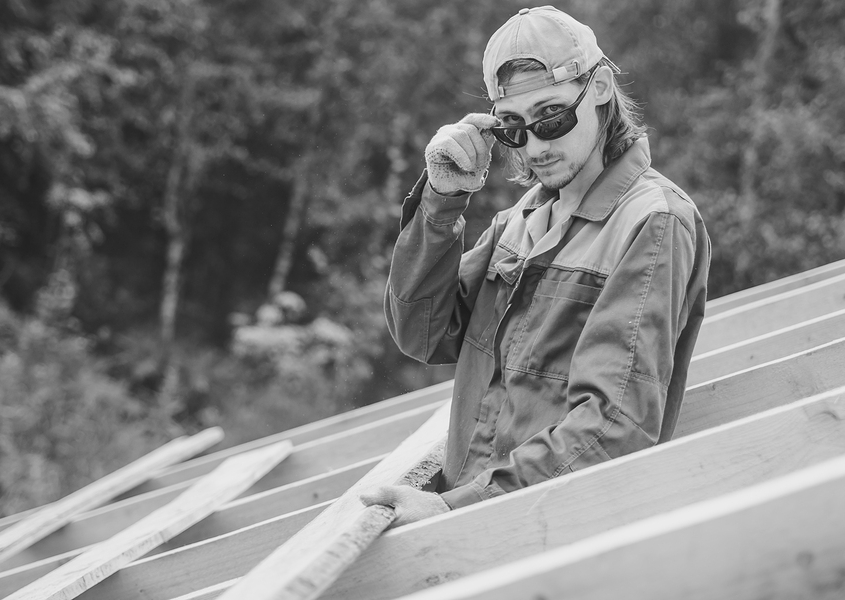 Roofer with sunglasses looking at camera