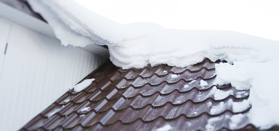 Winter snow on a tile roof