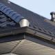 Corner of new zinc roof and zinc rain gutters on a house