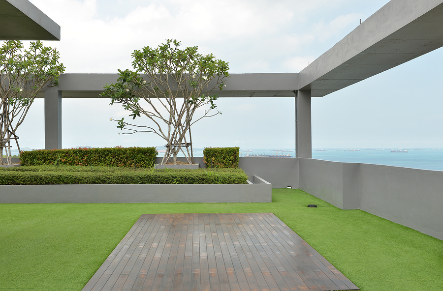 built up high rise flat roof with garden and tiled walkways