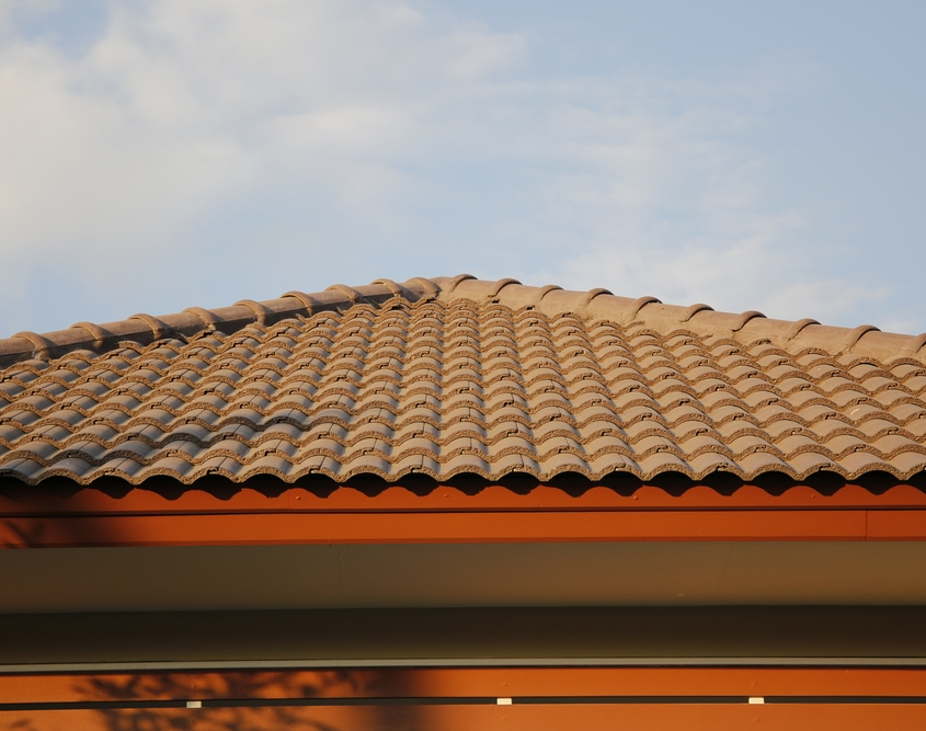 Clay roof tiles on a gently sloped roof brown and aged