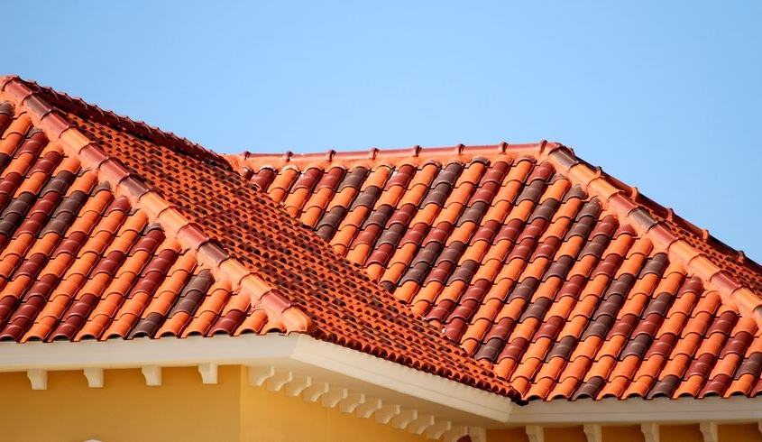 Multicolor concrete roof tiles on sloped roof