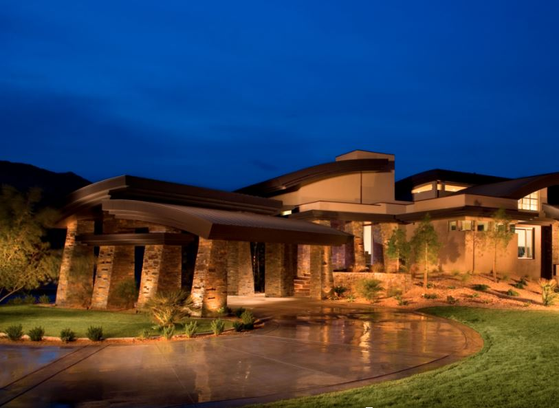 Luxury home at night with beautiful fire resistant copper roof